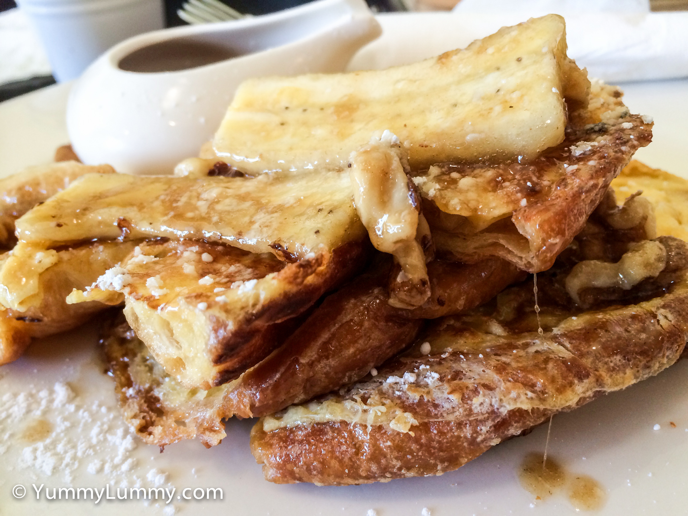 French toast with banana and maple syrup at U&Co Cafe