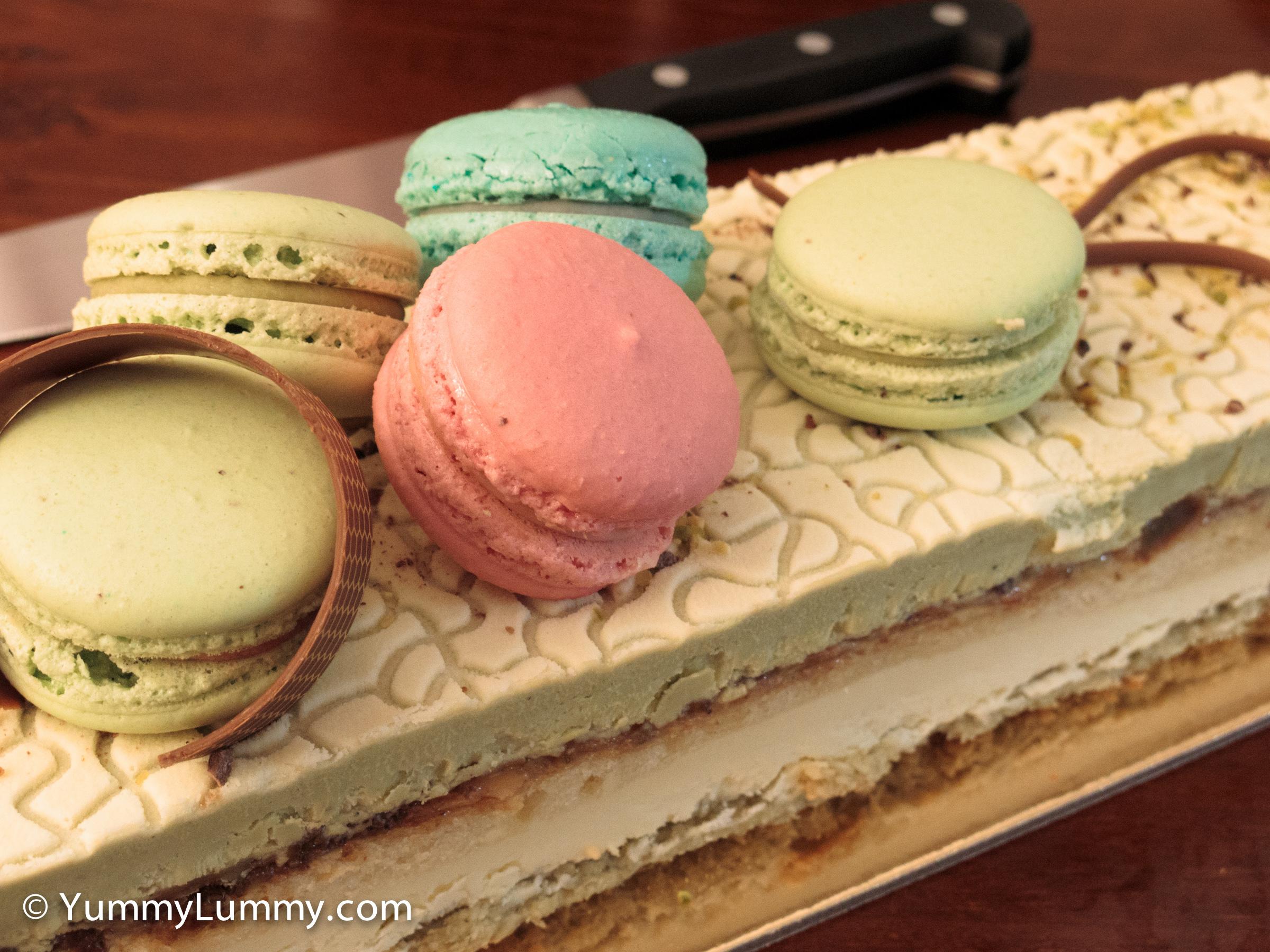 Flute pistachio cake with pistachio and white chocolate bavarois, coconut macaroon, leatherwood honey pistachio nougatine and vanilla cake