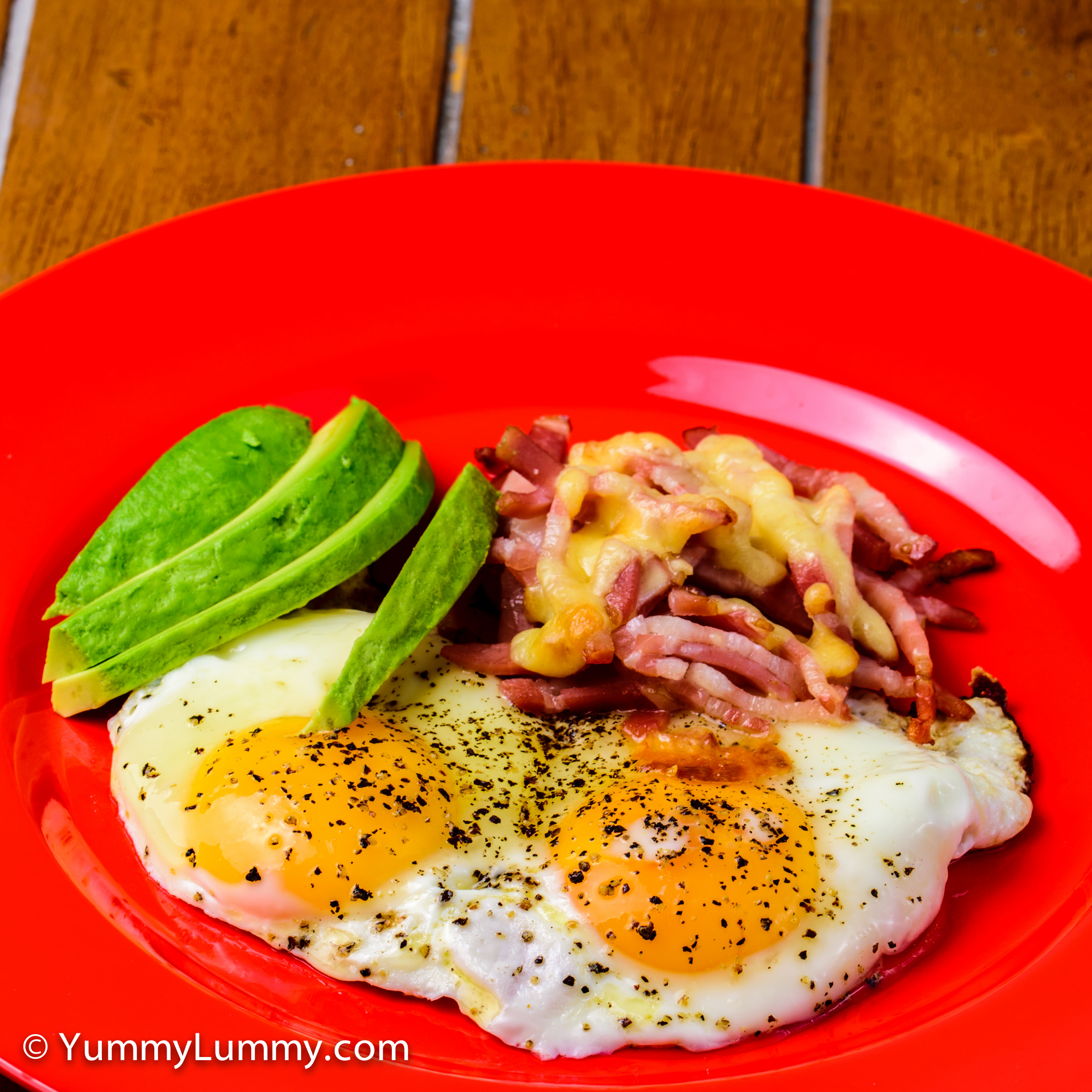 Happy hump day breakfast. Bacon and eggs with smoked cheddar cheese and avocado.