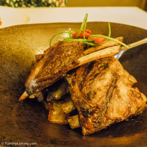 Manhan lamb ribs. Slow cooked Lamb Ribs in 'One Hundred' spices, finished on the grill, served with aged Chinese vinegar caramelised Banana chillies and soy caramelised Leeks.