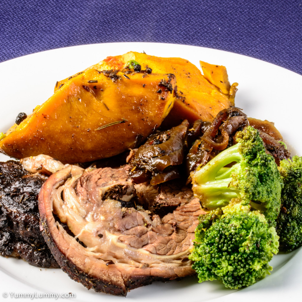 Sunday dinner. Pot roast beef brisket with pumpkin, broccoli, peas and ...