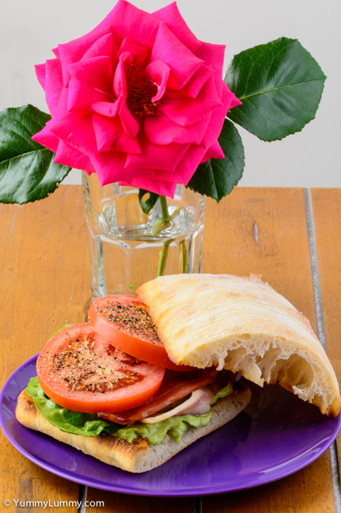 Saturday BLAT for lunch. Bacon lettuce avocado and tomato sandwich. The rose is from my garden. NIKON D7100 with 90.0 mm f/2.8 at 90mm and f/22, 1/5sec, ISO 400
