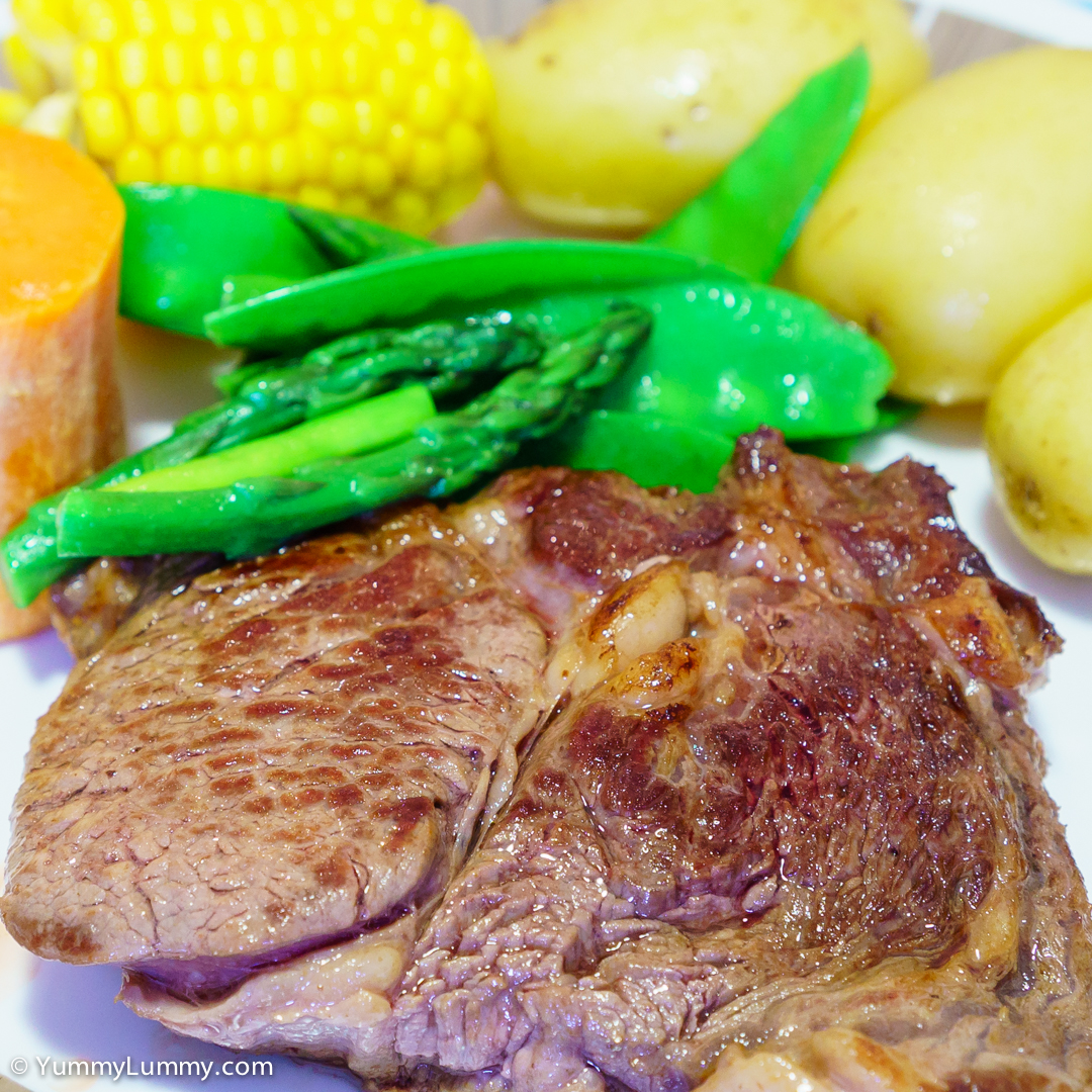 Saturday dinner. Scotch rib fillet with spuds, sweet potato, snow peas, asparagus and corn. SONY ILCE-7S with E 35mm F1.8 OSS at 35mm and f/5.6, 1/10sec, ISO 2000
