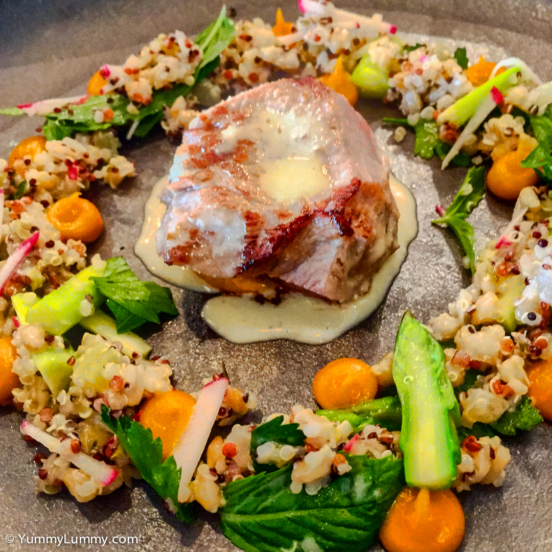 Veal loin with a wreath of asparagus, carrot, grains and blue cheese