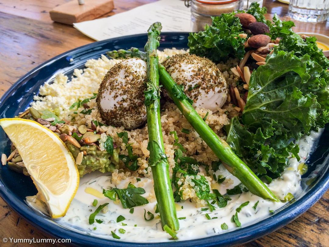 Green breaky plate with za'atar coated hard boiled eggs, kale, almonds, avocado, asparagus, quinoa tabouleh, feta, and dill yoghurt at Local Press on the Kingston Foreshore
