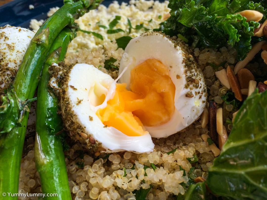 The cracked open hard boiled egg of the Green breaky plate with za'atar coated hard boiled eggs, kale, almonds, avocado, asparagus, quinoa tabouleh, feta, and dill yoghurt at Local Press on the Kingston Foreshore