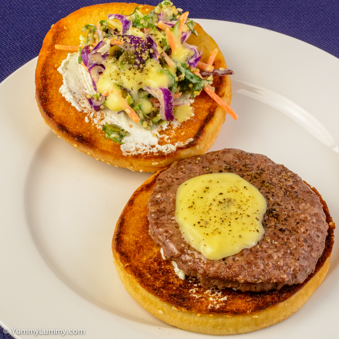 Angus beef burger on a hamburger bun spread with Persian feta and served with quinoa kale coleslaw with Gravox® Hollandaise sauce NIKON D7100 with 40.0 mm f/2.8 at 40mm and f/16, 1/50sec, ISO 400