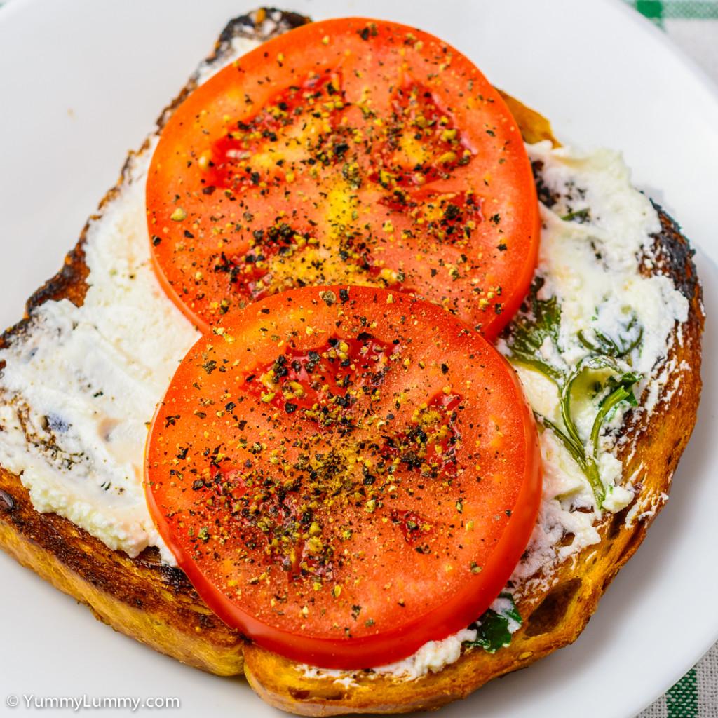 Tomato on fried bread spread with Persian feta