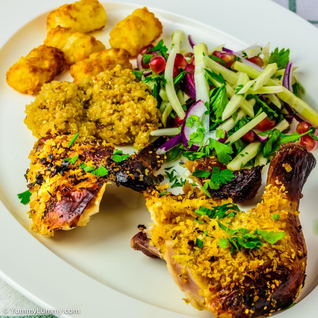 Roasted chili and coriander chicken, fennel and pomegranate salad, quinoa and potato gems