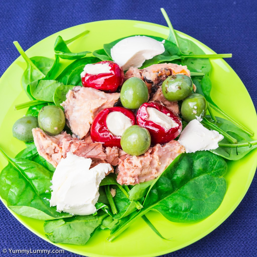 Sunday #lunch is canned pink salmon with feta stuffed peppers, green olives, cream cheese and spinach leaves.
