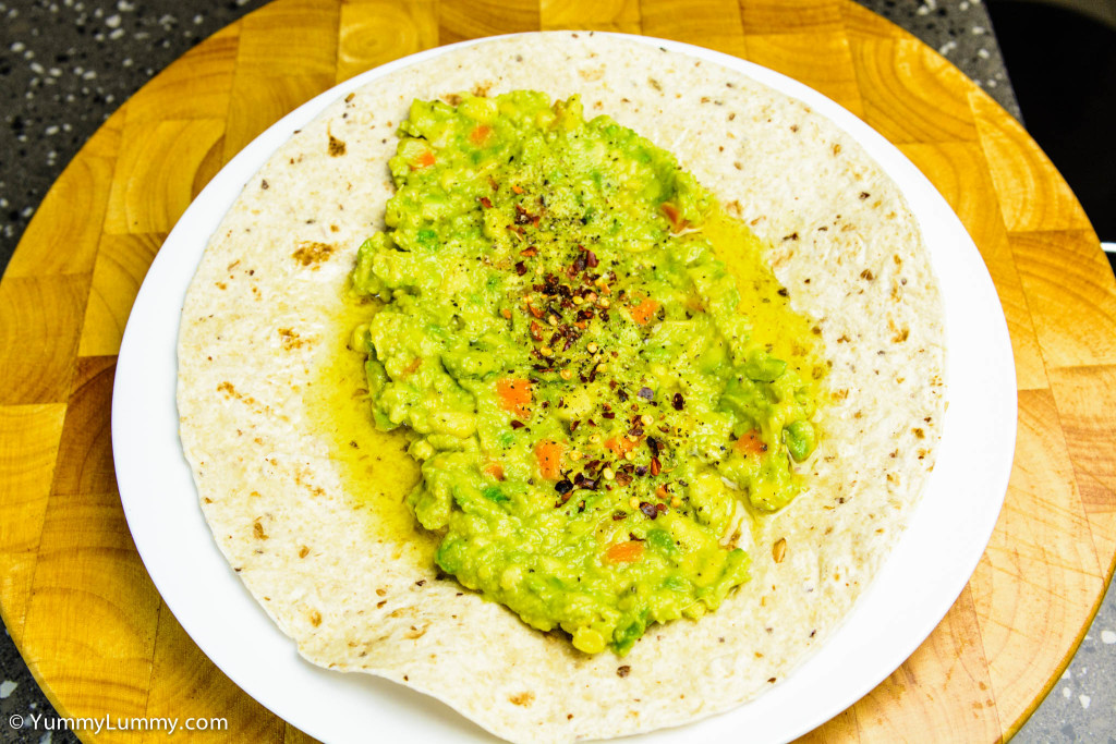 Helga's flatbread wrap with Essential Lemon Agrumato plus avocado pea smash (plus carrot and corn) seasoned with black cracked pepper and chili flakes