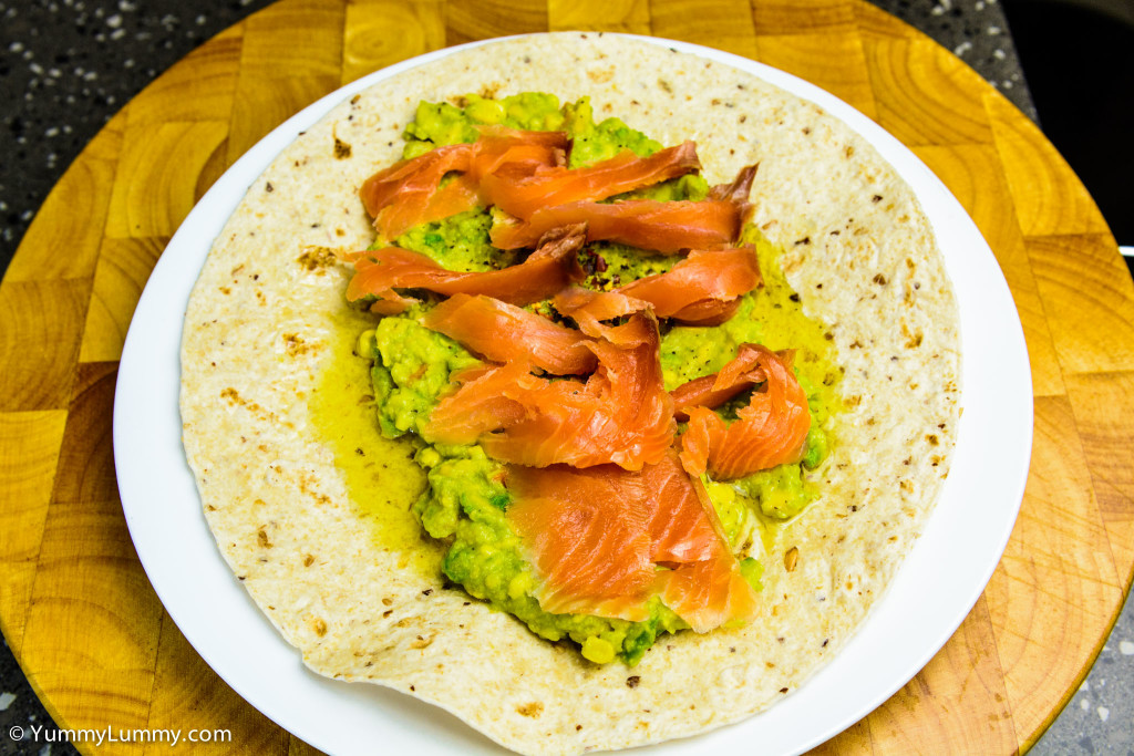 Helga's flatbread wrap with Essential Lemon Agrumato plus avocado pea smash (plus carrot and corn) seasoned with black cracked pepper and chili flakes topped with smoked salmon