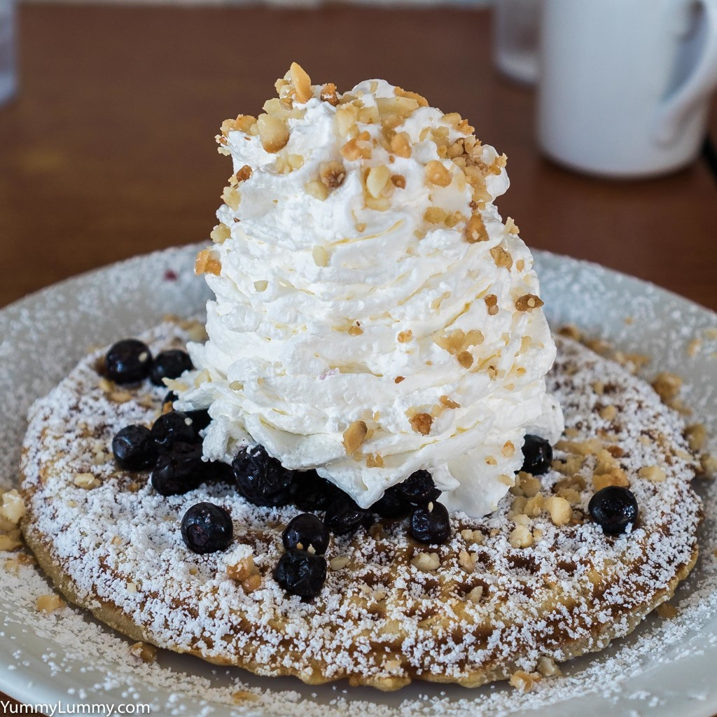 Blueberry whipped cream and Queensland nut waffle