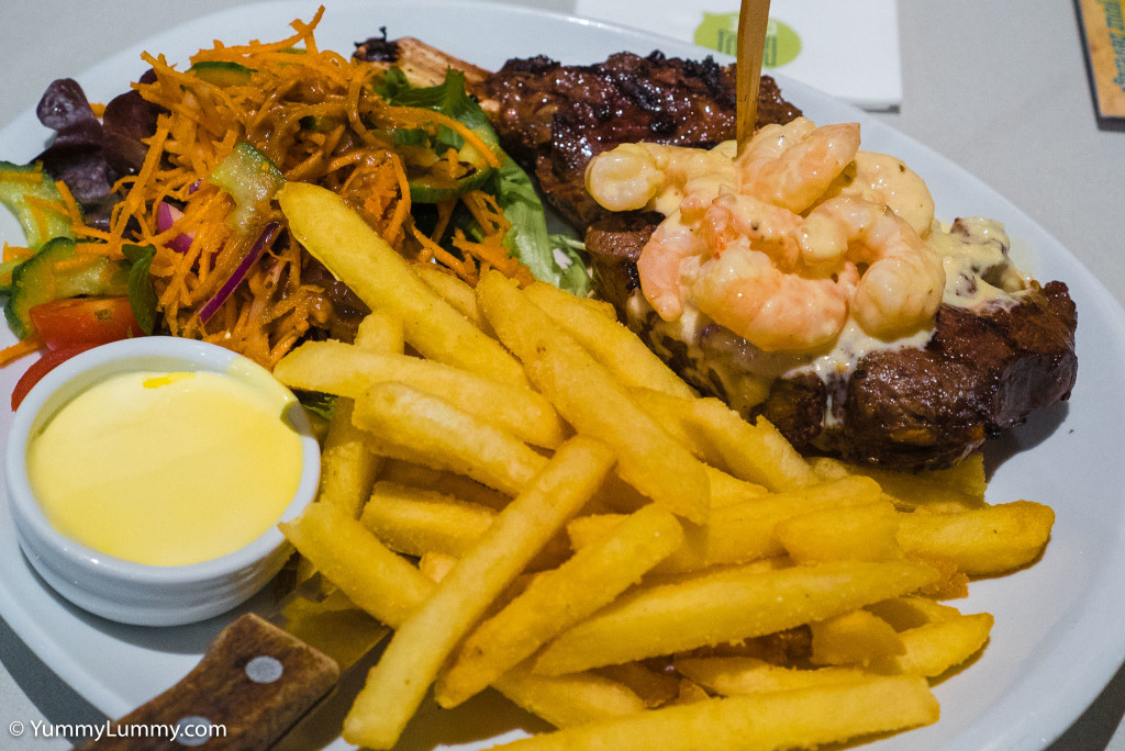 My surf and turf, prime rib on the bone with garlic prawns at HQ Cafe at Kedron-Wavell Services Club