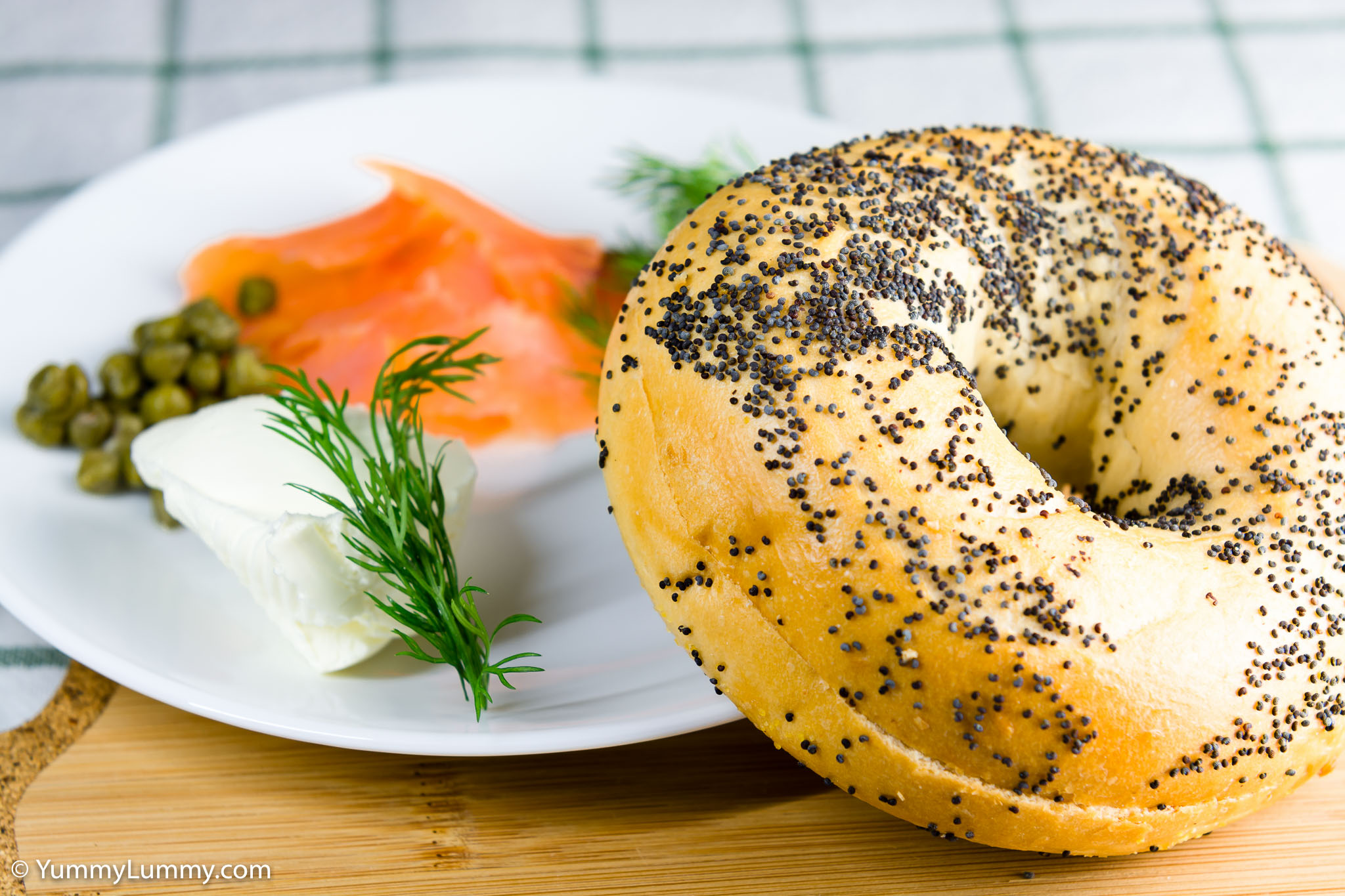 Smoked salmon, cream cheese, dill and capers on a poppyseed bagel for lunch