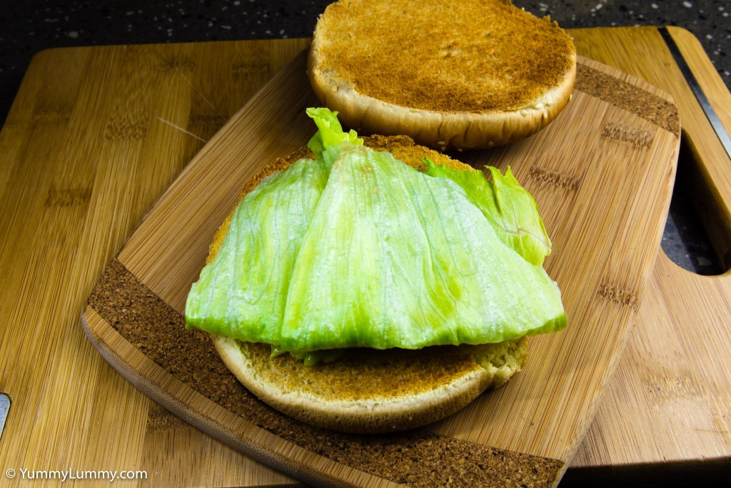 Hot and spicy jalapeño avocado on the bread roll with iceberg lettuce
