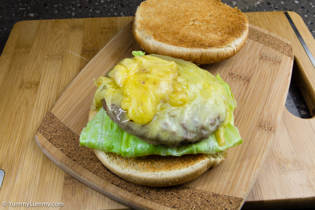 Hot and spicy jalapeño avocado on the bread roll with iceberg lettuce and beef burger topped with Coon cheese