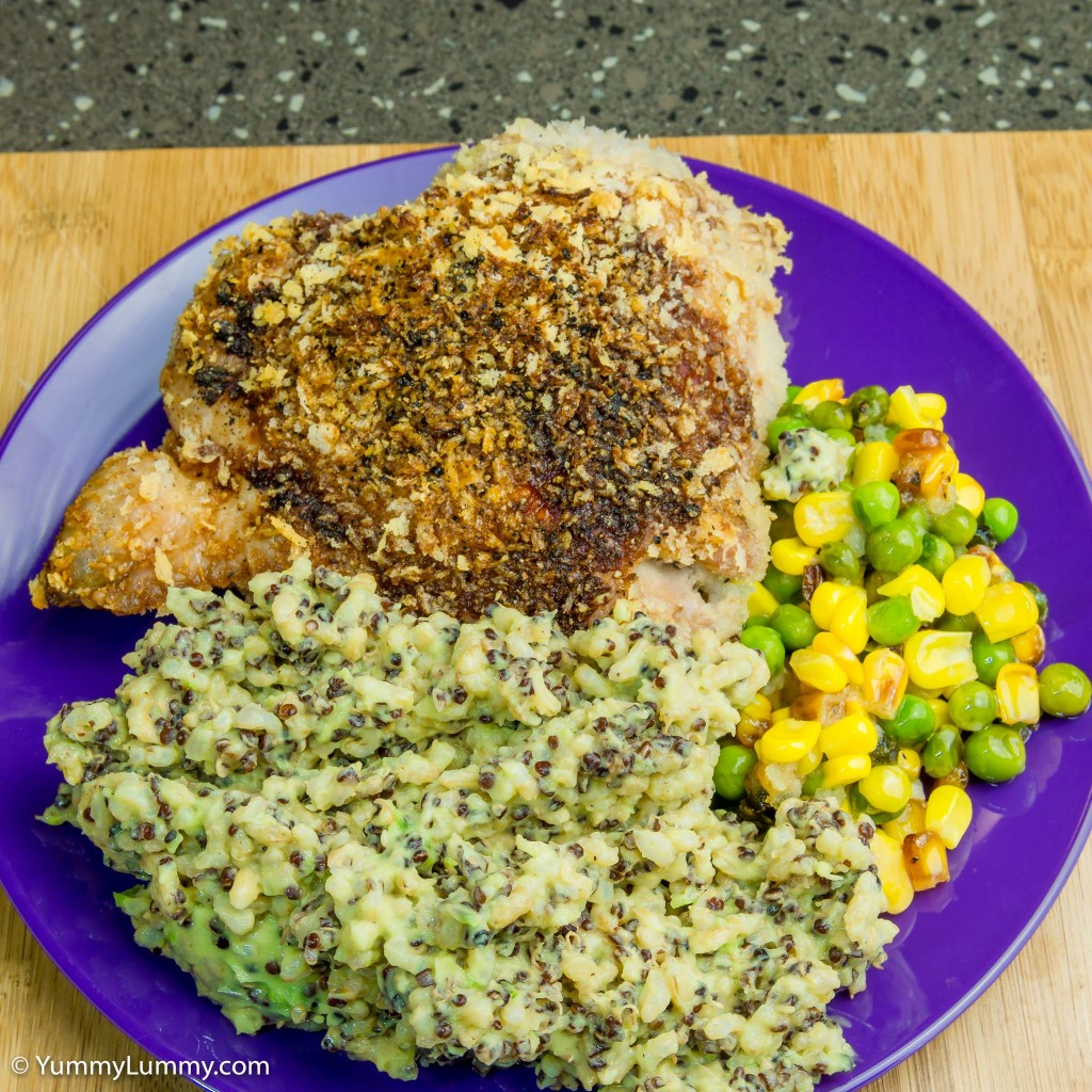 Chicken thigh with avocado quinoa rice and peas and corn