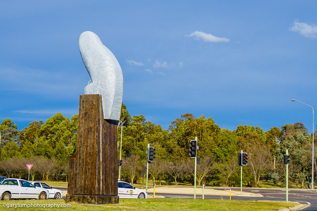 The Belconnen Owl statue from behind. It doesn't look much like an owl from this angle. It looks more like an erect penis.
