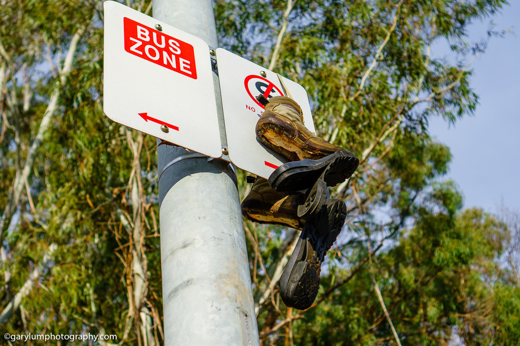 Old shoes thrown high onto a sign