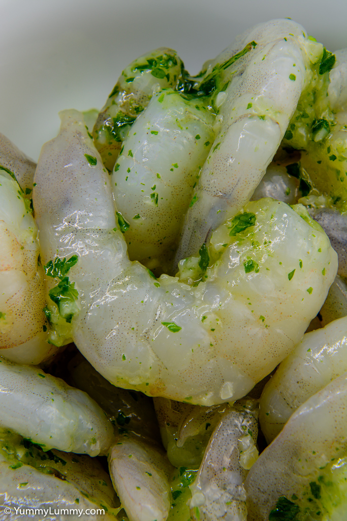 Raw garlic prawns and parsley