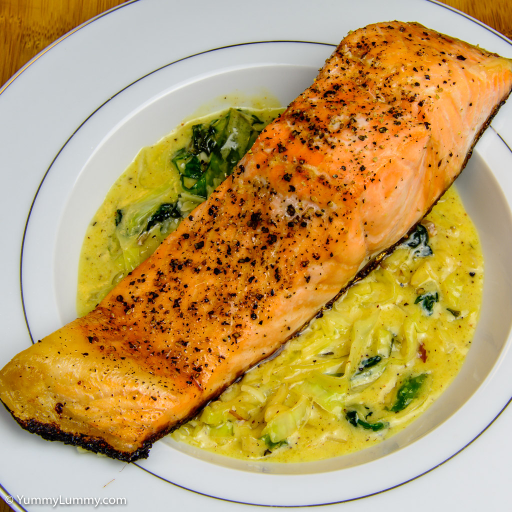 Salmon with creamy cabbage and spinach leaves