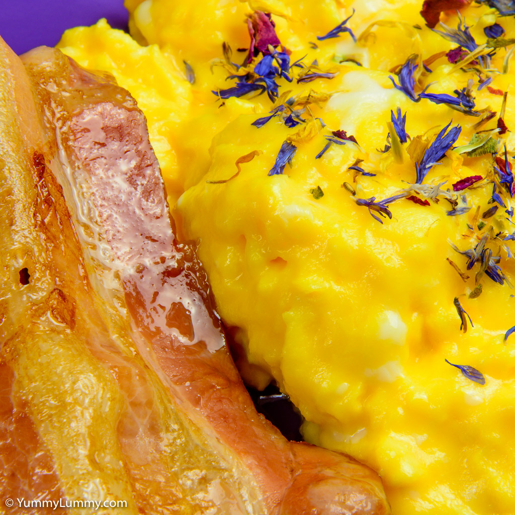 Streaky bacon and creamy buttery scrambled eggs