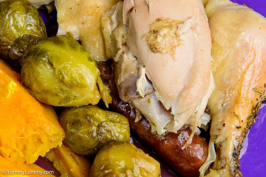 Close up of roast chicken with vegetables