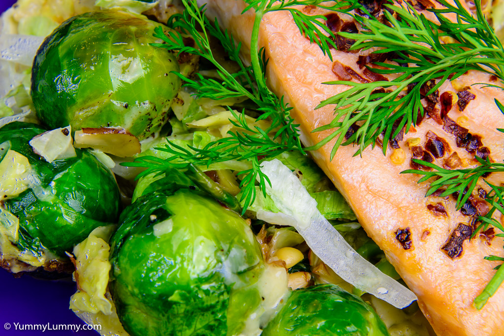 Close up of baked salmon and creamy cabbage with Brussels sprouts