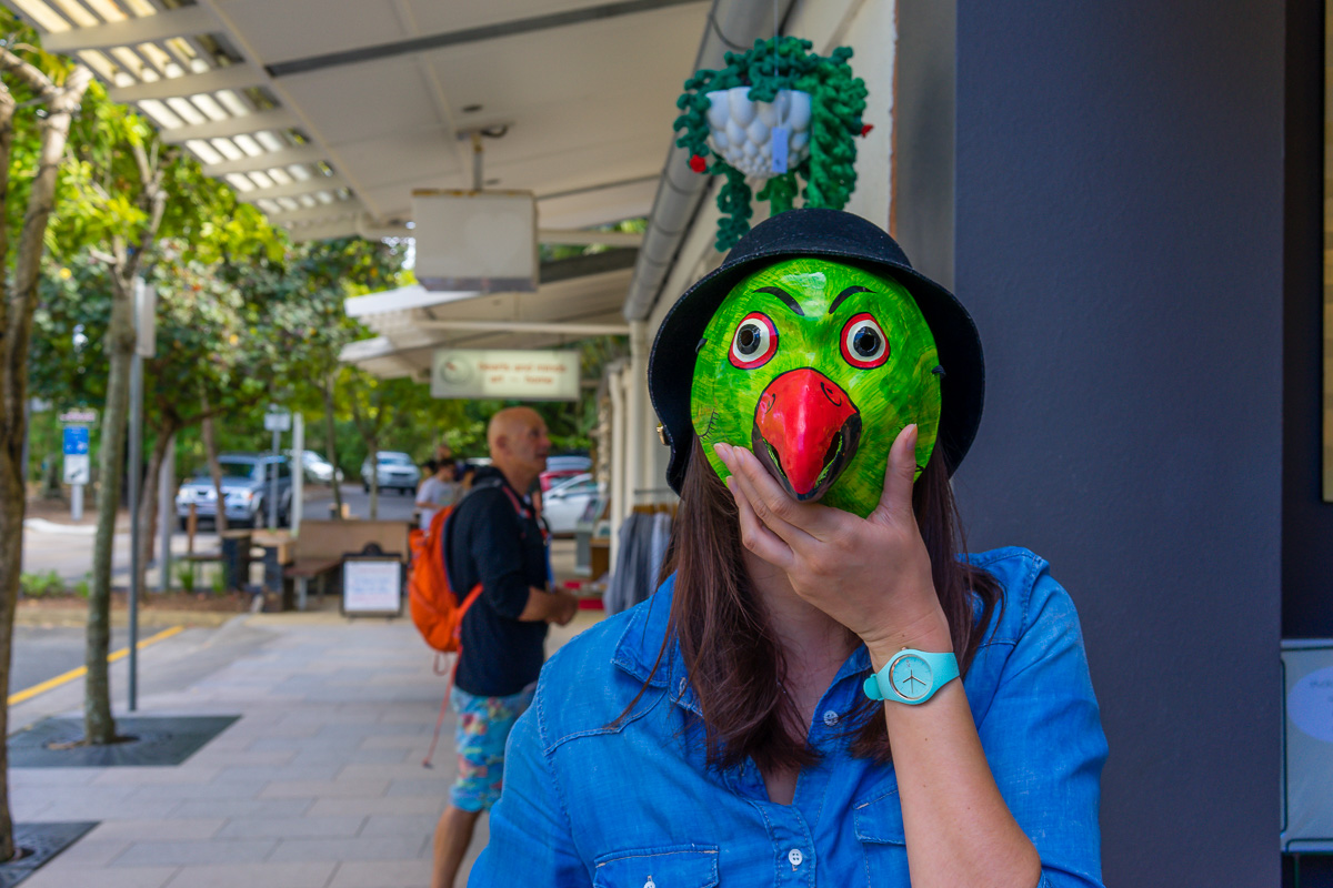 Miss20 with a mask on Hastings Street Noosa