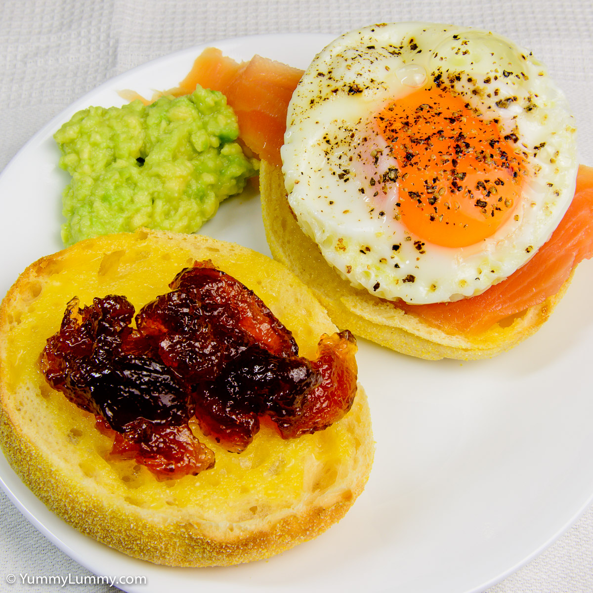 Egg and salmon on English muffin with avocado plus marmalade