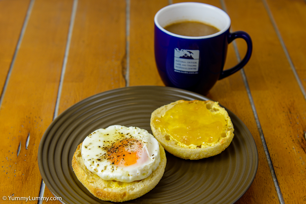 Sunday breakfast. English muffin with a fried egg and Buderim ginger  marmalade with chocolate coffee.