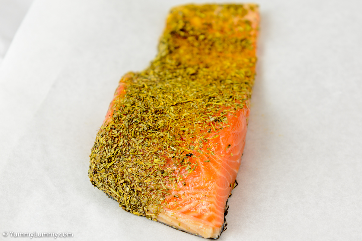 Salmon with dried mixed herbs and curry powder.