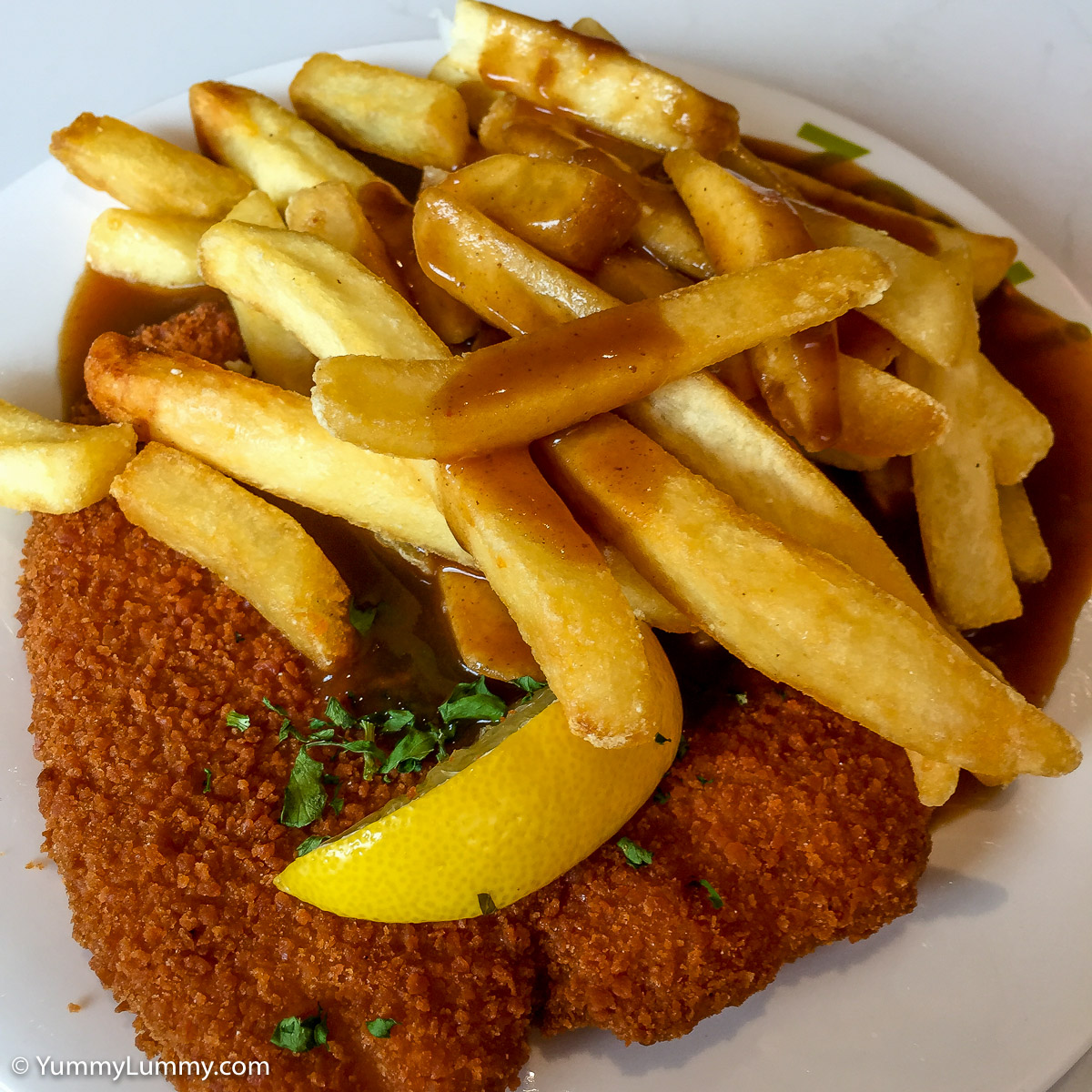 TGIF lunch. Chicken schnitzel with chips and gravy.