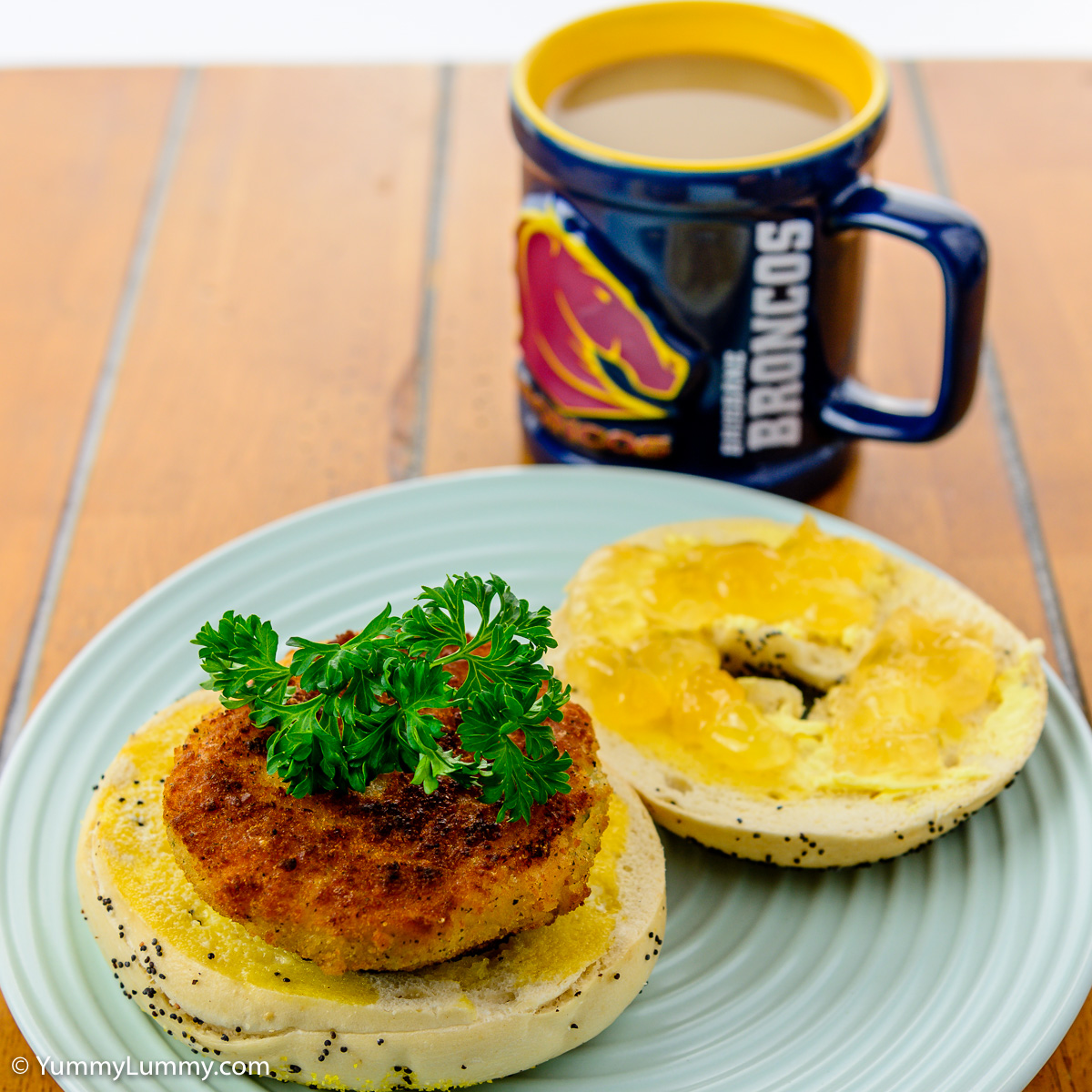 Sunday breakfast. Salmon cake on a poppyseed bagel with marmalade and a coffee.