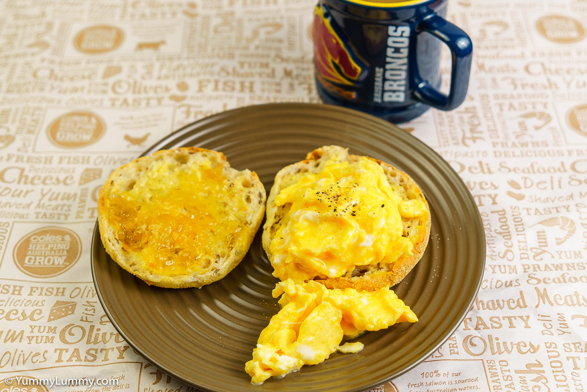 Sunday breakfast. Low fat scrambled eggs on a wholemeal English muffin with Buderim Ginger Factory ginger, lemon and lime marmalade with coffee.