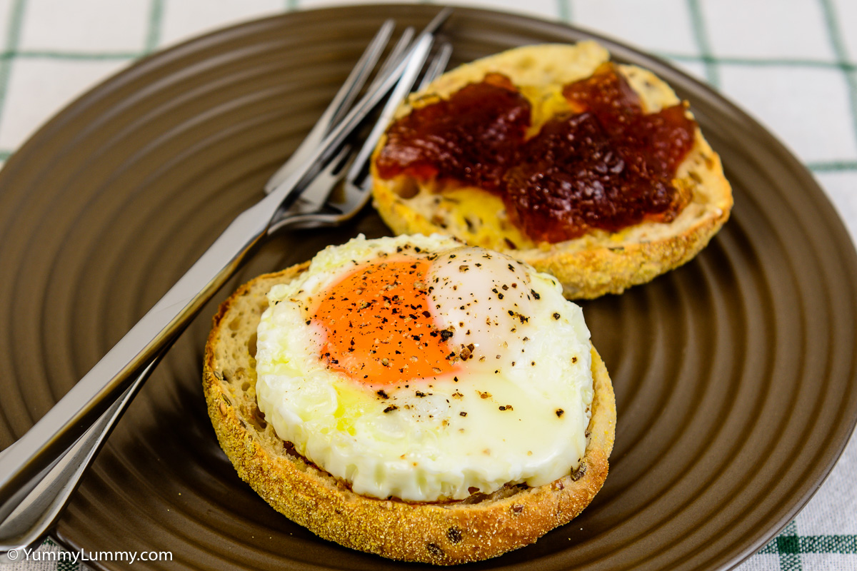 Tuesday breakfast. Fried egg on a whole grain English muffin with some Oxford marmalade.