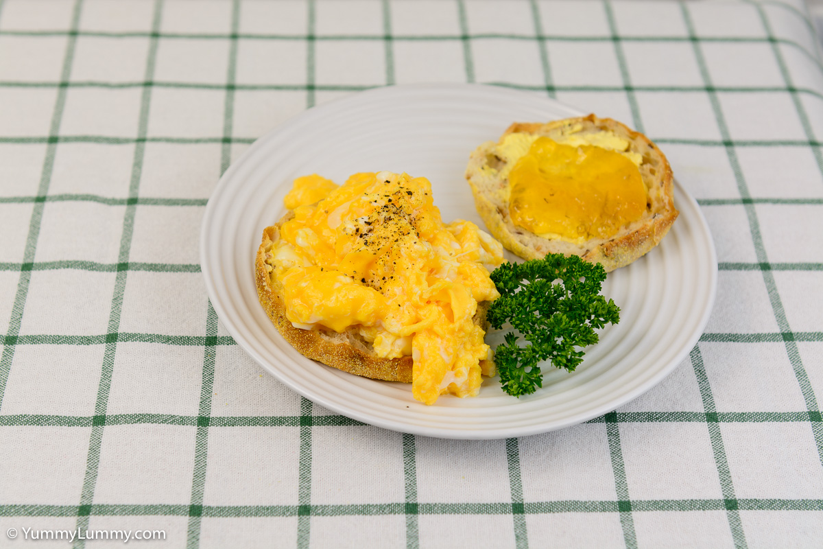 Saturday breakfast. Low fat scrambled eggs on a whole grain English muffin with some Buderim Ginger Factory ginger, lemon and lime marmalade.
