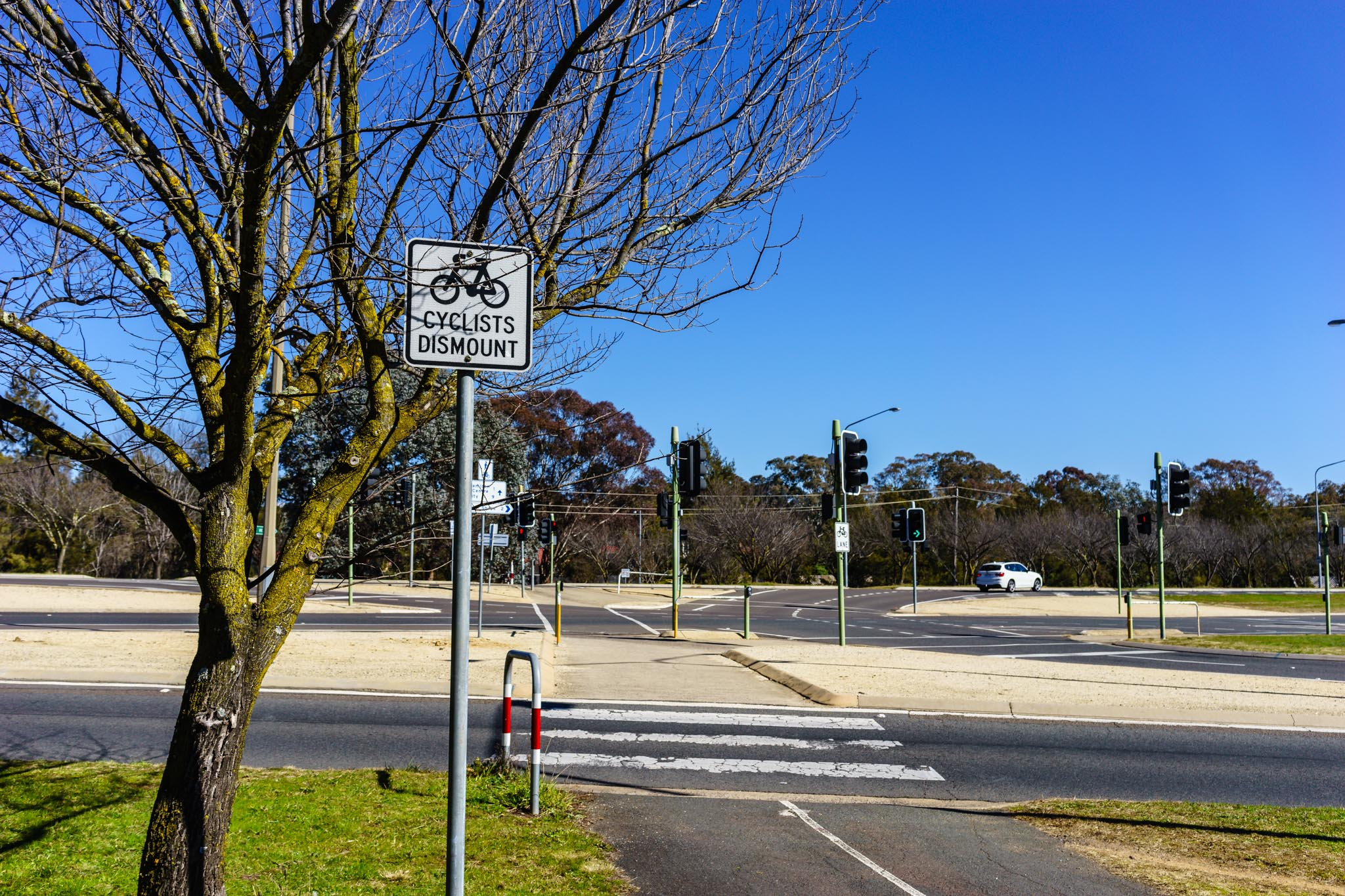 Cyclists dismount sign Benjamin Way. I've never seen a cyclist dismount in Canberra.
