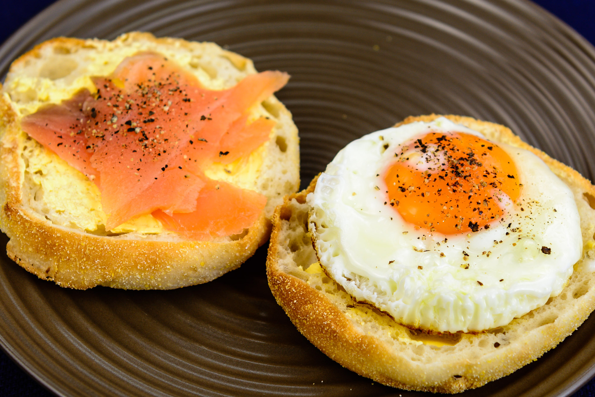 Monday breakfast. Fried egg and smoked salmon on an English muffin.