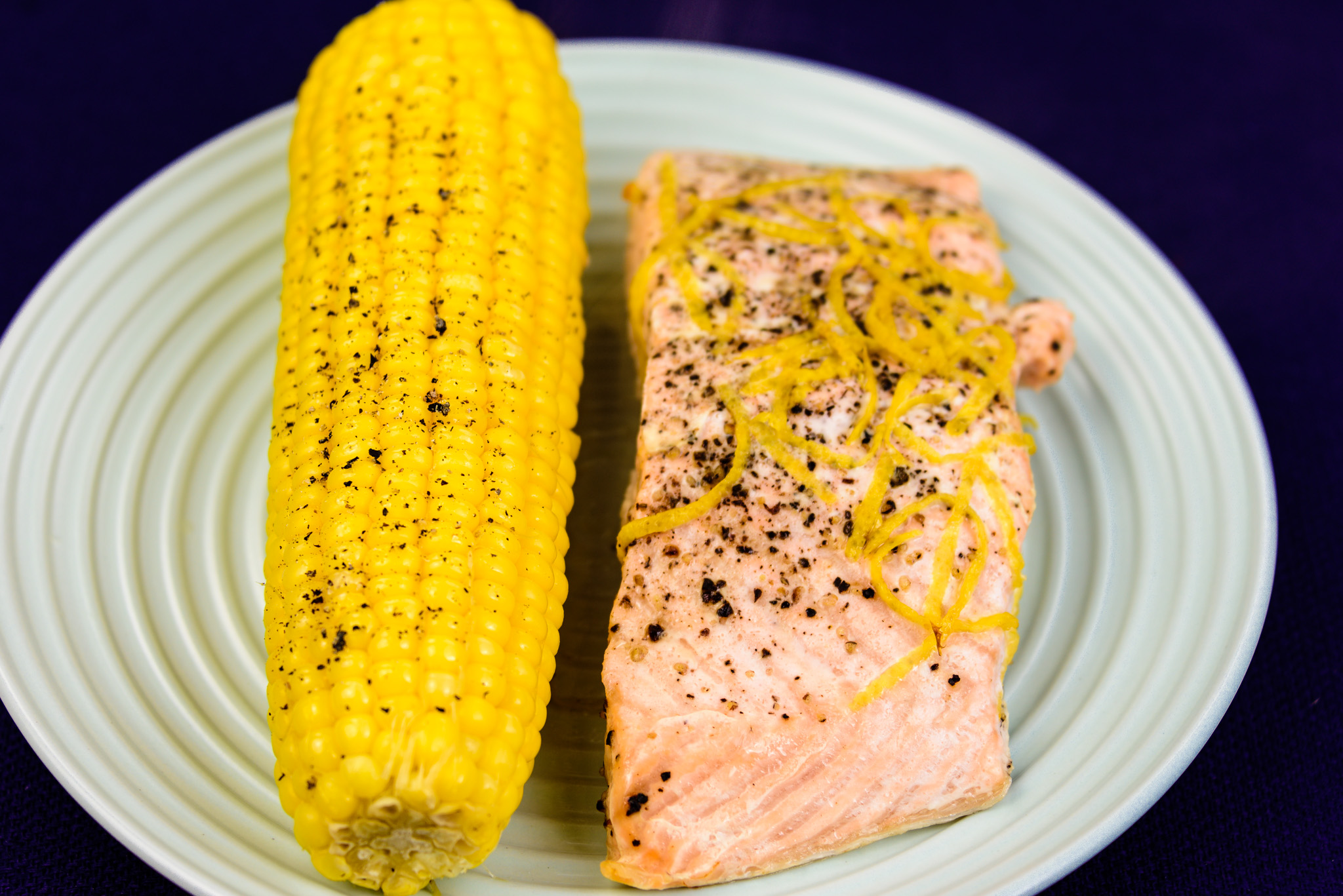 Monday dinner. Salmon cooked in paper with sweet corn on the cob.