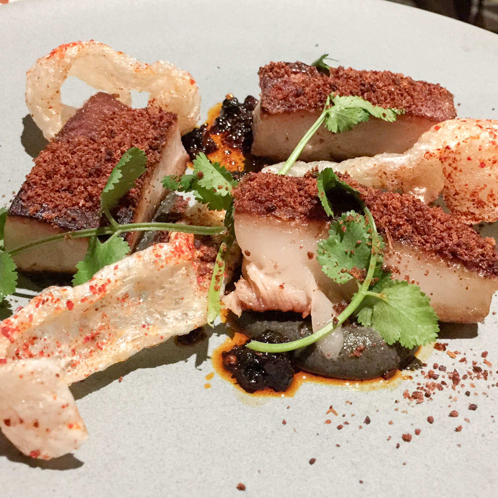 Twice cooked pigs cheek, pigs cheek, burnt eggplant, hoi sin, scallop floss, Sichuan vinaigrette vinaigrette