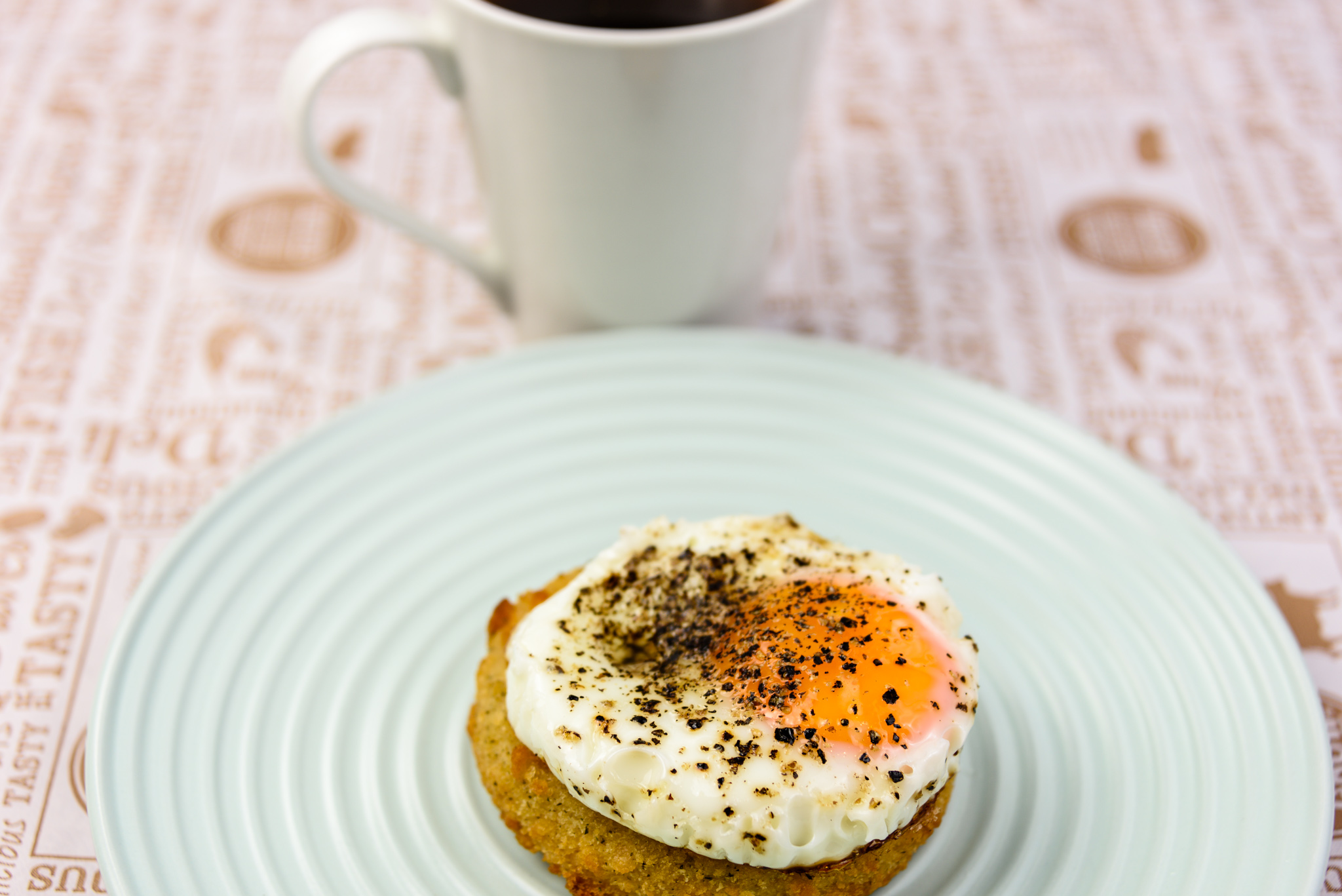 Saturday breakfast. Fried egg on a salmon rissole with coffee.