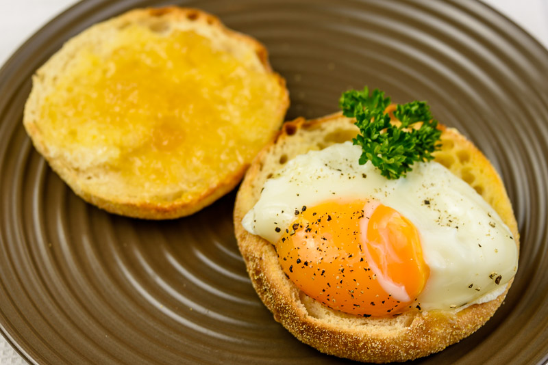 Saturday breakfast. Fried egg on English muffin with Buderim Ginger Factory ginger marmalade.
