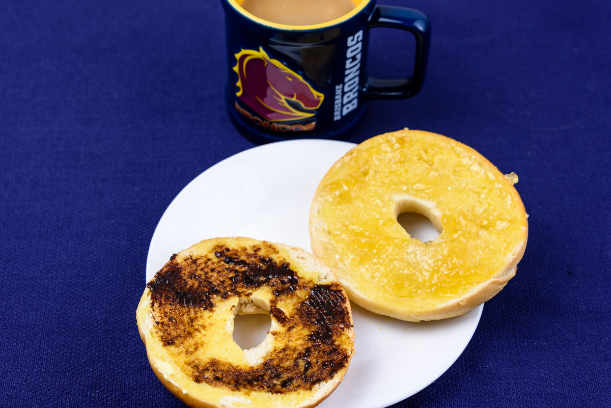 Tuesday breakfast. Bagel with vegemite and marmalade.