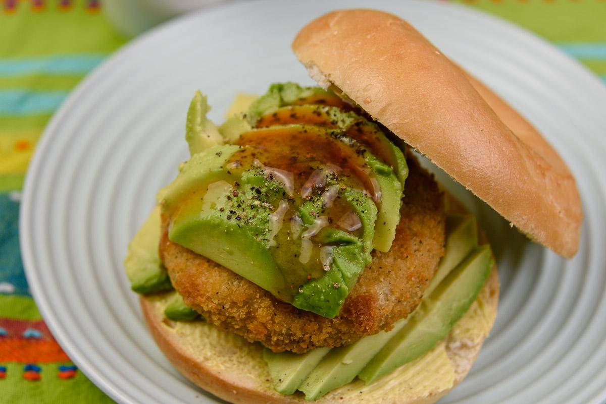 Tuesday breakfast. Salmon rissole and avocado on a plain bagel.