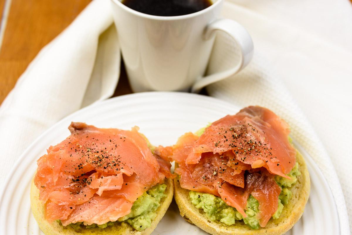 TGIPD breakfast. Smoked salmon and avocado on an English muffin with a mug of coffee.