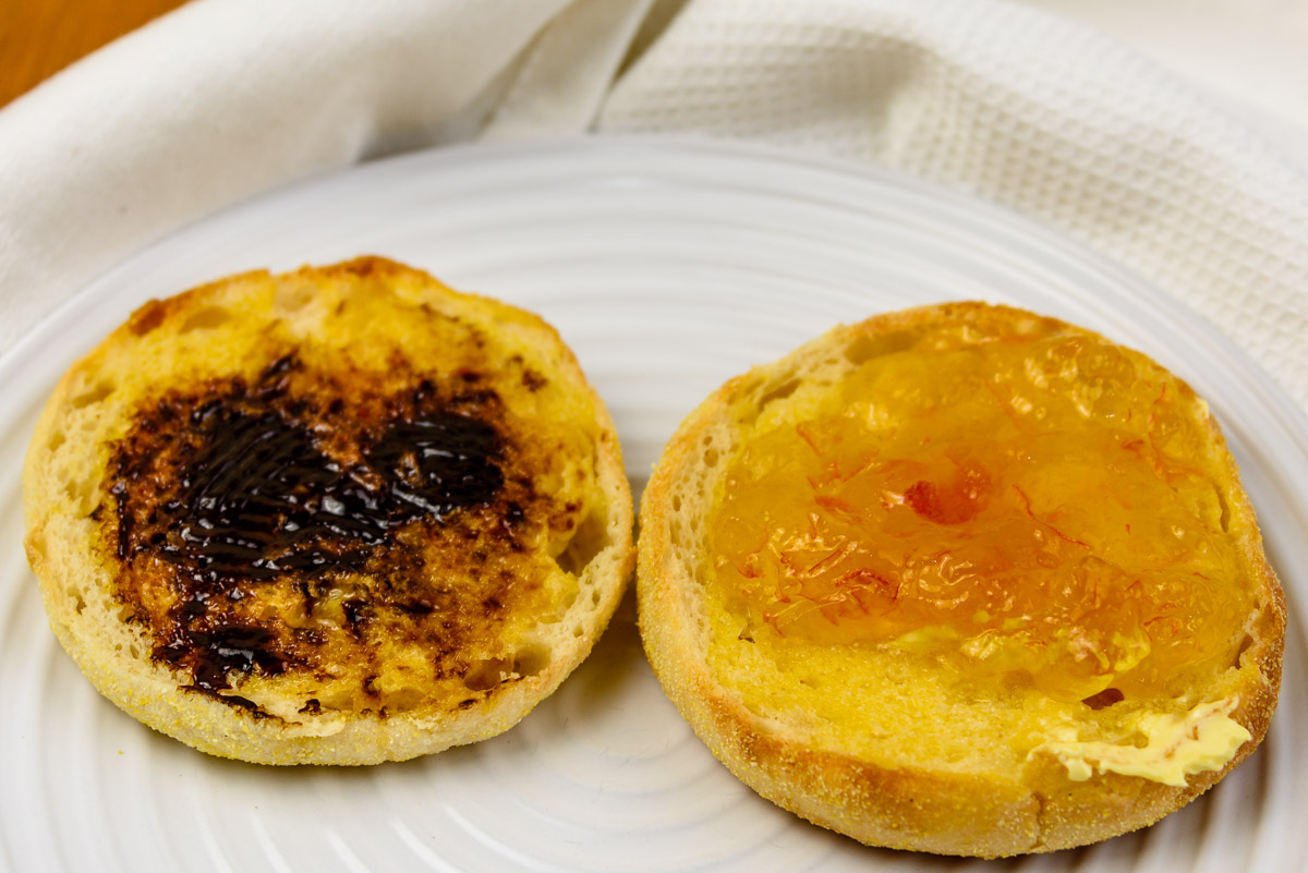 Saturday breakfast. Vegemite and marmalade on an English muffin.
