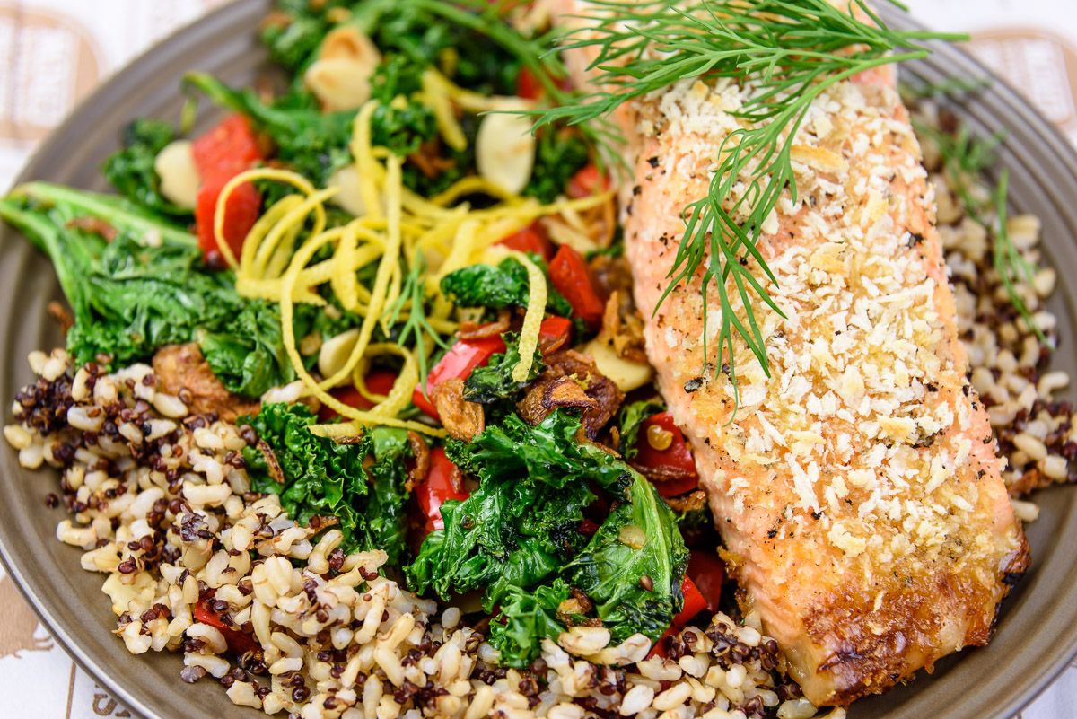 Monday dinner. Panko encrusted baked salmon with quinoa rice served with kale, capsicum, chili, dill, lemon zest, almond flakes and fried shallots.