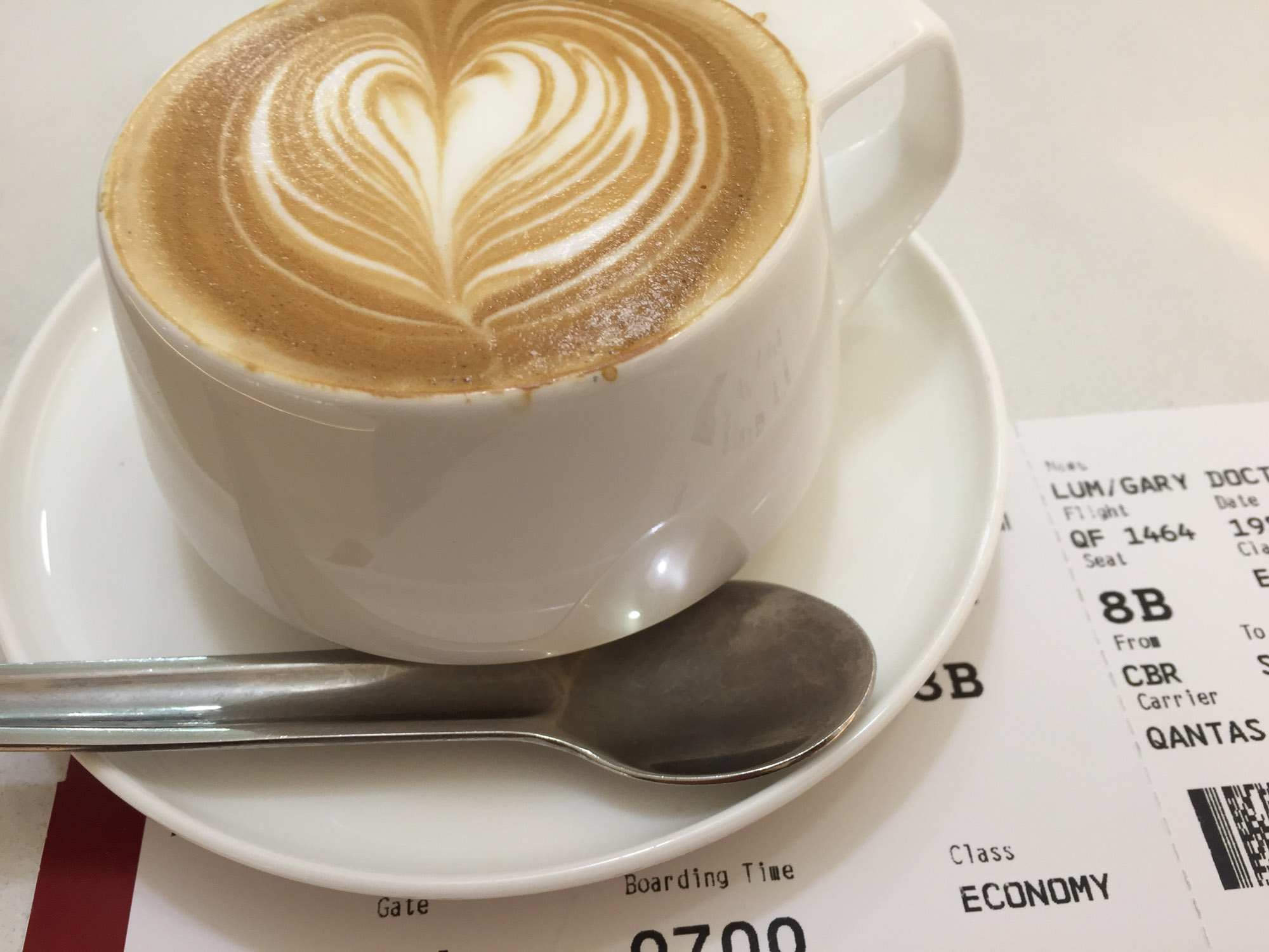 Boarding pass and coffee QF1464